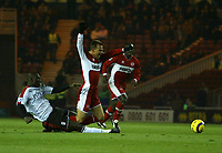 Photo: Andrew Unwin.<br /> Middlesbrough v Fulham. The Barclays Premiership.<br /> 20/11/2005.<br /> Middlesbrough's Szilard Nemeth (C) is fouled by Fulham's Papa Bouba Diop (L).