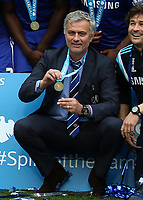 Football - 2014 / 2015 Premier League - Chelsea vs. Sunderland.   <br /> <br /> José Mourinho, Manager, of Chelsea FC shows his winners medal at Stamford Bridge. <br /> <br /> COLORSPORT/DANIEL BEARHAM