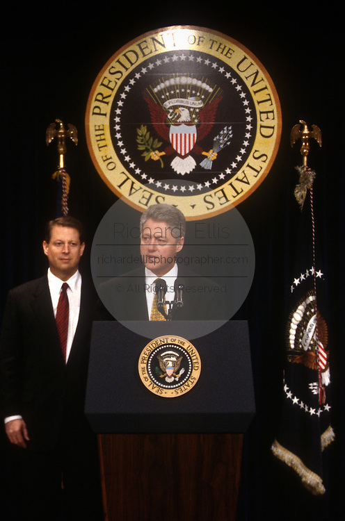 US President Bill Clinton releases the Fiscal Year 1998 Federal Budget as Vice President Al Gore watches during a press conference in the Old Executive Office building February 6, 1997 in Washington, DC. Clinton unveiled his 1.69 trillion USD budget which he says will balance the budget by the year 2002.