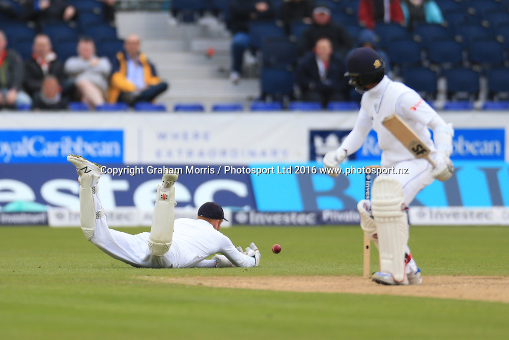 Jonny Bairstow drops Dinesh Chandimal off the bowling of James Anderson (left) during the second Investec Test Match between England and Sri Lanka at Chester-le-Street, Durham. Photo: Graham Morris/ Photosport.nz