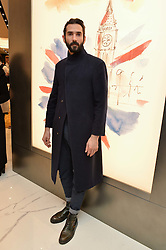 LUKE WALLER at the launch of the new Giusepe Zanotti store in Conduit Street, London on 26th October 2016.