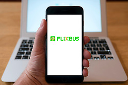 Flixbus coach operator logo on website on smart phone screen.