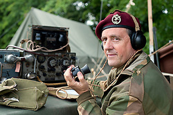 A reenactor portrays a radio operator of the 21st Independent Parachute Company at the Northallerton Wartime Weekend.18th and 19th June  2011.<br />