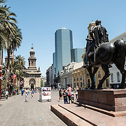 An equestian statue of Valdivia, the Spanish conquistador who founded Santiago in 1541, in Plaza de Armas in the center of Santiago de Chile. In the background at left is the Metropolitan Cathedral of Santiago de Chile.