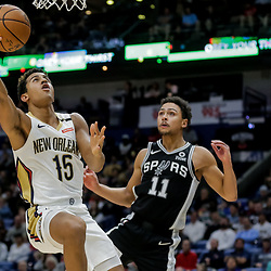 Nov 19, 2018; New Orleans, LA, USA; New Orleans Pelicans guard Frank Jackson (15) shoots over San Antonio Spurs guard Bryn Forbes (11) during the second quarter at the Smoothie King Center. Mandatory Credit: Derick E. Hingle-USA TODAY Sports