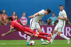 June 17, 2017 - Saint Petersburg, Russia - Fedor Smolov (L) of the Russian national football team and Ryan Thomas of the New Zealand national football team vie for the ball during the 2017 FIFA Confederations Cup match, first stage - Group A between Russia and New Zealand at Saint Petersburg Stadium on June 17, 2017 in St. Petersburg, Russia. (Credit Image: © Igor Russak/NurPhoto via ZUMA Press)