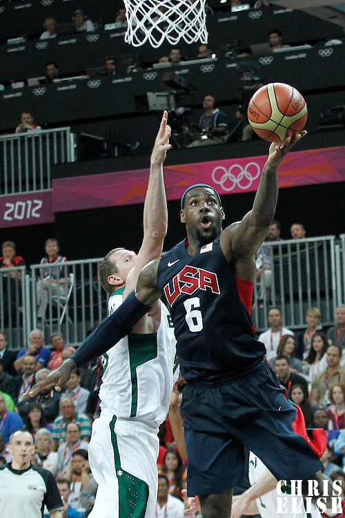 04 August 2012: USA LeBron James goes for the layup past Lithuania Darius Songaila during 99-94 Team USA victory over Team Lithuania, during the men's basketball preliminary, at the Basketball Arena, in London, Great Britain.