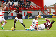 Hearts FC Defender Igor Rossi and Hamilton Academical Midfielder Darren Lyon have a bad collision  during the Ladbrokes Scottish Premiership match between Hamilton Academical FC and Heart of Midlothian at New Douglas Park, Hamilton, Scotland on 24 January 2016. Photo by Craig McAllister.