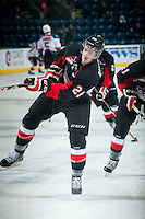KELOWNA, CANADA - JANUARY 3: Josh Anderson #28 of Prince George Cougars takes a shot during warm up against the Kelowna Rockets on January 3, 2015 at Prospera Place in Kelowna, British Columbia, Canada.  (Photo by Marissa Baecker/Shoot the Breeze)  *** Local Caption *** Josh Anderson;