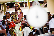 Ramatu Armatu and her 6-month-old daughter Sekinatu (7.7kg) wait to get vaccinated at the Osu Maternity Home in Accra, Ghana on Tuesday June 16, 2009.