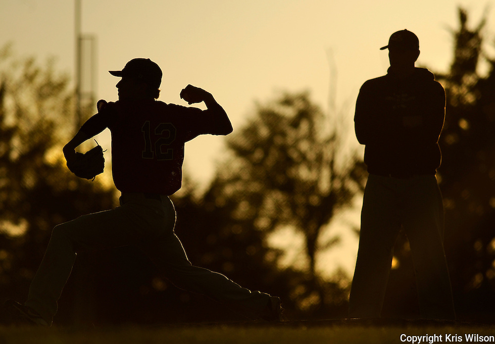 Kris Wilson/News Tribune.Jefferson City relief pitcher Connor Arcobasso warms up under the eye of head coach Brian Ash after replacing Jay's starter Corey Beard on the mound during Friday's loser's bracket matchup with Hickman in the Capitol City Baseball Invitational at Legion Field.