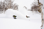 Gerry Lopez pulls into Taro Tamai's barrel in the Niseko, Hokkaido, Japan backcountry. This plan was hatched in the Onsen the night before. It took two tries, but it worked. Two men in their 50s and 60s acting like kids--the true spirit of snowboarding on display.