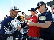 PEORIA, AZ - FEBRUARY 24:  Yonder Alonso #23 of the San Diego Padres signs a ball for a fan prior to the spring training game against the Seattle Mariners at Peoria Sports Complex on February 24, 2013 in Peoria, Arizona.  (Photo by Jennifer Stewart/Getty Images) *** Local Caption *** Yonder Alonso