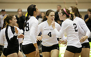 West Point, NY - Army players gather together on the court during a match against Lehigh in the Patriot League women's volleyball tournament at the United States Military Academy on  Nov. 21, 2009.