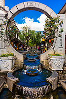 A beautiful water fountain and archway in the Old Town (Dali Gucheng) of Dali, Yunnan Province, China.