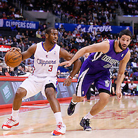 23 November 2013: Los Angeles Clippers point guard Chris Paul (3) drives past Sacramento Kings point guard Greivis Vasquez (10) during the Los Angeles Clippers 103-102 victory over the Sacramento Kings at the Staples Center, Los Angeles, California, USA.