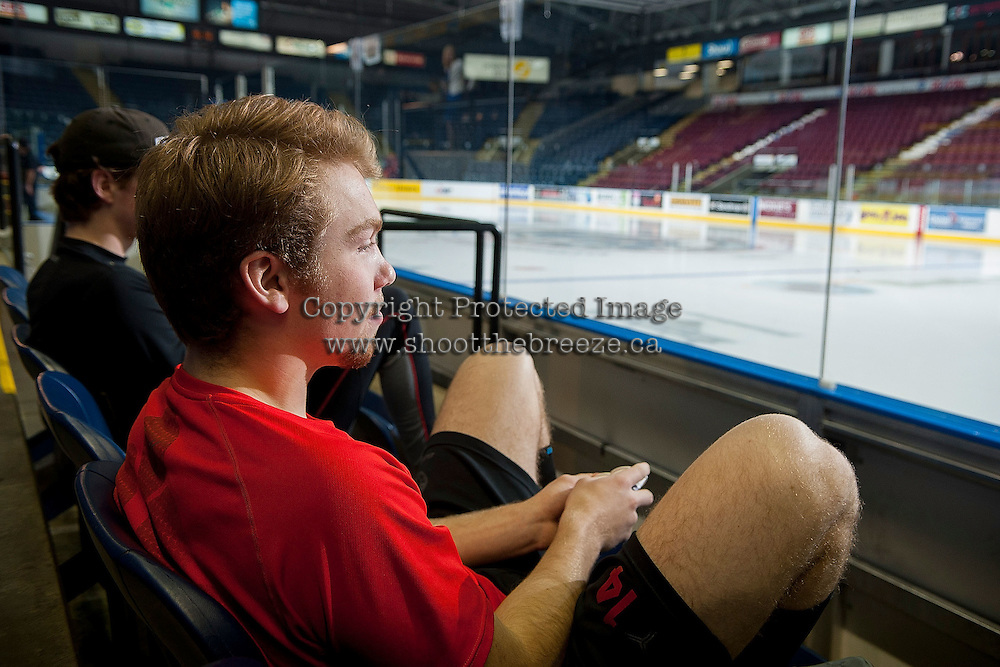 KELOWNA, CANADA - NOVEMBER 21: Rourke Chartier #14 of Kelowna Rockets sits in the stands before the game against the Portland Winterhawks on November 21, 2014 at Prospera Place in Kelowna, British Columbia, Canada.  (Photo by Marissa Baecker/Shoot the Breeze)  *** Local Caption *** Rourke Chartier;