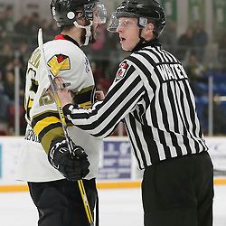 TRENTON, ON  - MAY 5,  2017: Canadian Junior Hockey League, Central Canadian Jr. &quot;A&quot; Championship. The Dudley Hewitt Cup. Game 7 between The Georgetown Raiders and The Powassan Voodoos.  Ryan Theriault #15 of the Powassan Voodoos is held back by OHA Linesman during an altercation <br /> (Photo by Amy Deroche / OJHL Images)