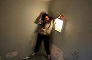 A girl standing next to a light box