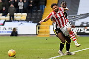 Notts County midfielder Enzio Boldewijn (11) commits a foul on Lincoln City midfielder Bruno Andrade (11) during the EFL Sky Bet League 2 match between Notts County and Lincoln City at Meadow Lane, Nottingham, England on 2 February 2019.