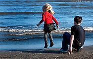 Kaelyn Terminie, 4, jumps up and down as she and her brother, Gavin Terminie, 11, watch dolphins play March 6, 2011 at Grand Isle State Park in Grand Isle, La. The island was heavily impacted by the Deepwater Horizon oil spill April 20, 2010 and continues to recover. The beach has been closed since the oil spill but re-opened in February. (Photo by Carmen K. Sisson/Cloudybright)