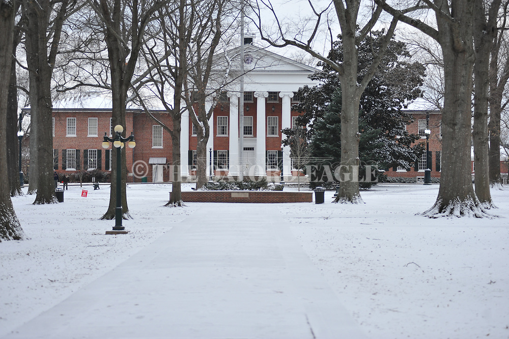 The Lyceum and the Circle are covered in snow, in Oxford, Miss. on Tuesday, February 11, 2014. A thin layer of ice covered by snow has closed area schools. (AP Photo/Oxford Eagle, Bruce Newman)