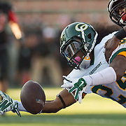 Santa Ana, CA - Grossmont College wide receiver Deshaan LIddell-Pataesil stretchs past Santa Ana College defensive back Kevin Zargan. Grossmont won the game played NOvember 8, 2014.