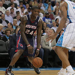 05 November 2008: Atlanta Hawks forward Marvin Williams (24) defended by New Orleans Hornets forward David West (30) during the first half of a NBA game between the New Orleans Hornets and the Atlanta Hawks at the New Orleans Arena in New Orleans, LA..