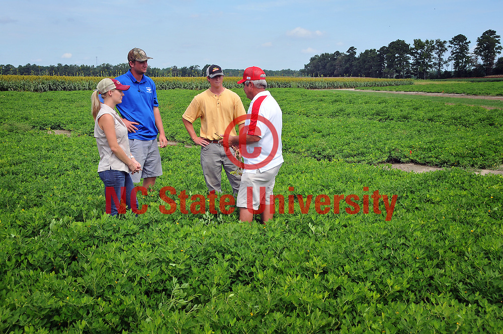 Dewayne Johnson, technician in the Department of Crop Science, shows peanut plants to attendees of the annual Peanut Day.