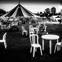 White plastic chairs beside tent at festival