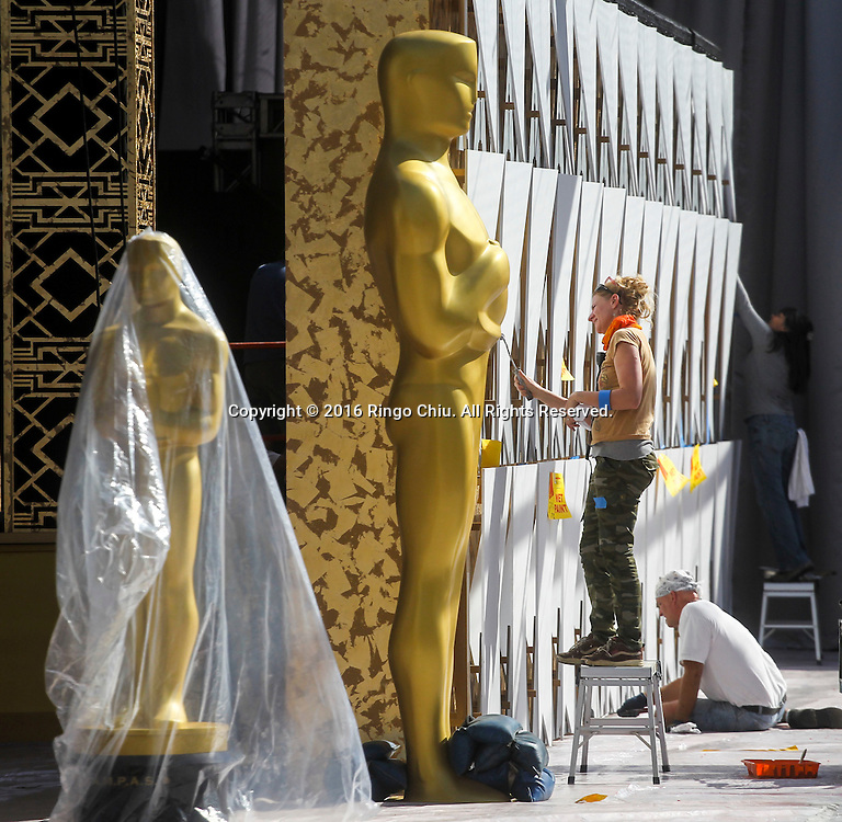 Workers paint the scenic walls in the red carpet arrivals area in front of the Dolby Theatre on Thursday Feb. 25, 2016 in Los Angeles. The 88th Academy Awards will be held Sunday, February 28, 2016. (Photo by Ringo Chiu/PHOTOFORMULA.com)<br /> <br /> Usage Notes: This content is intended for editorial use only. For other uses, additional clearances may be required.