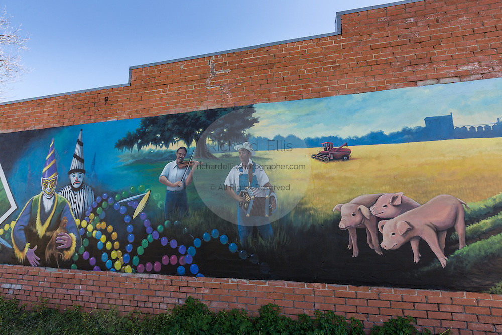 Mural painted along a building of showing the Cajun culture in Basile, Louisiana.