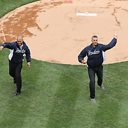 Mariano Rivera, (left) and Andy Pettitte throw out the first pitch during the New York Yankees V Baltimore Orioles home opening day at Yankee Stadium, The Bronx, New York. 7th April 2014. Photo Tim Clayton