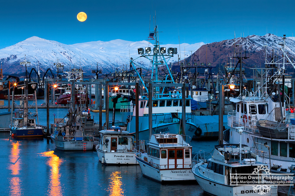 Moonset over St. Herman Harbor in Kodiak, Alaska