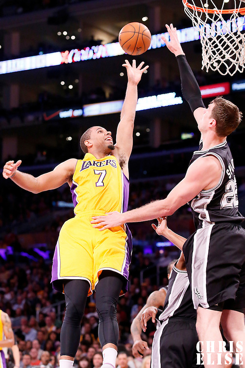 19 March 2014: Los Angeles Lakers forward Xavier Henry (7) goes for the jumper over San Antonio Spurs center Tiago Splitter (22) during the San Antonio Spurs 125-109 victory over the Los Angeles Lakers at the Staples Center, Los Angeles, California, USA.
