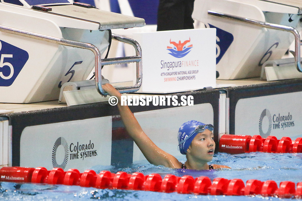Ashley Lim reacts after the girls' 400m IM timed finals at the 47th Singapore National Age Group Swimming Championships. She finished first among the 11 year olds with a timing of 5:28.81, breaking the previous meet record by nearly nine seconds. (Photo © Chua Kai Yun/Red Sports)