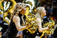 November 13th, 2013:  A Colorado Buffaloes cheerleader perform during a second half time out in the NCAA Basketball game between the University of Wyoming Cowboys and the University of Colorado Buffaloes at the Coors Events Center in Boulder, Colorado