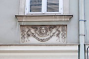 Architectural details on the facade of a building in the historic 7th district of Vienna, Austria