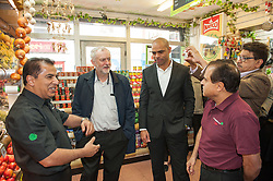 © Licensed to London News Pictures.01/04/2016. Bristol, UK. JEREMY CORBYN visits the Sweetmart in St Marks Road in Easton, Bristol, support Labour's candidate Marvin Rees (right in the picture from JC) in the Bristol Mayoral Election, and Labour candidates in the local elections.  Photo credit : Simon Chapman/LNP