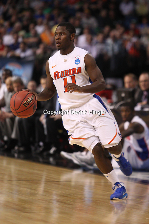 Mar 17, 2011; Tampa, FL, USA;Florida Gators guard Erving Walker (11)  during first half of the second round of the 2011 NCAA men's basketball tournament against the UC Santa Barbara Gauchos at the St. Pete Times Forum.  Mandatory Credit: Derick E. Hingle