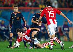 Nelson Valdez of Paraguay vs Sergio Busquets of Spain  during the  2010 FIFA World Cup South Africa Quarter Finals football match between Paraguay and Spain on July 03, 2010 at Ellis Park Stadium in Johannesburg. (Photo by Vid Ponikvar / Sportida)
