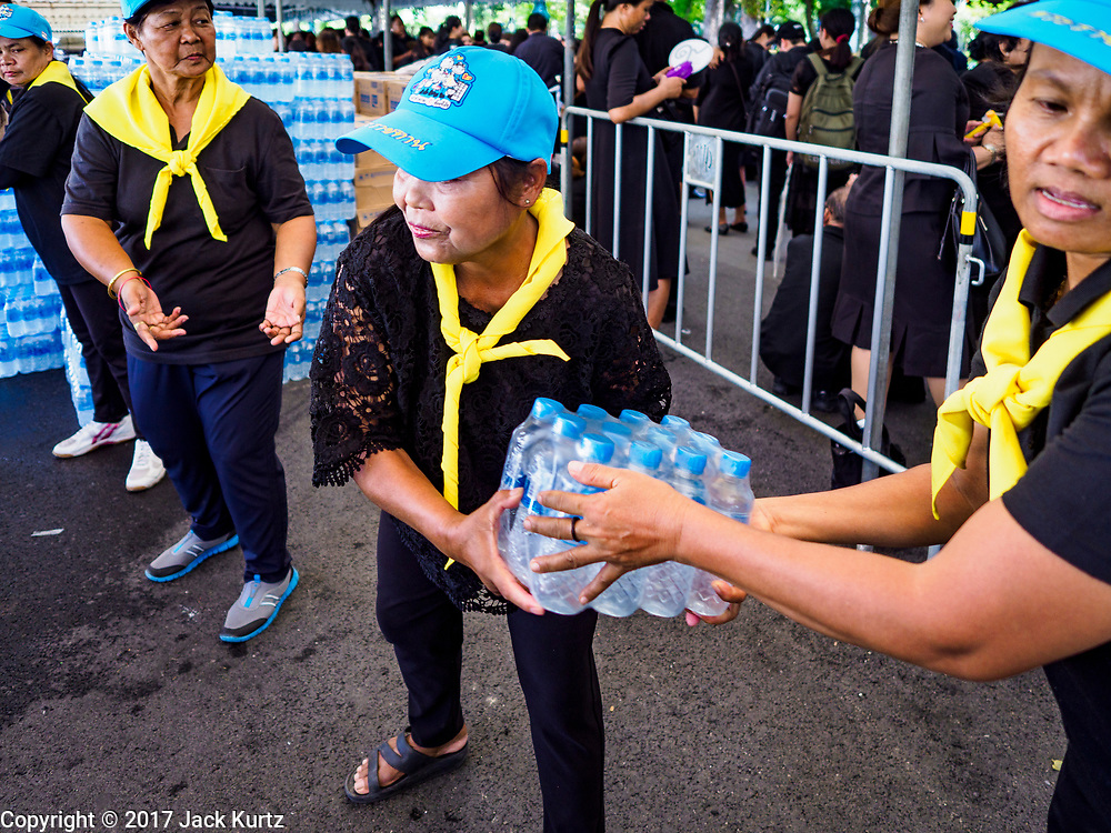 27 SEPTEMBER 2017 - BANGKOK, THAILAND: Volunteers stack bottles of water to be handed out to mourners at the Grand Palace in Bangkok. The Royal Household has announced that the palace will close to the public, including tourists, on 04 October 2017 to allow officials to complete preparations for the cremation of Bhumibol Adulyadej, the King of Thailand, who died on 13 October 2016. They also extended the official mourning period by 15 days. It was originally set to end on 13 October 2017 but now will end on 26 October 2017, the day of the King's cremation.    PHOTO BY JACK KURTZ