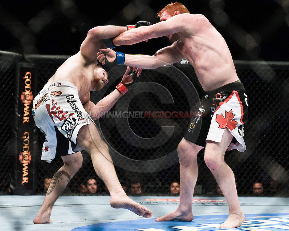 """NEWARK, NEW JERSEY, MARCH 27, 2010: Jim Miller (left) and Mark Bocek are pictured during their bout at """"UFC 111: St. Pierre vs. Hardy"""" in the Prudential Center, New Jersey on March 27, 2010"""