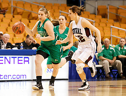 Fayetteville guard Racheal Mankins (44) drives to the basketball against Wheeling Central's Sydney Bennington (22) during a first round game at the Charleston Civic Center.