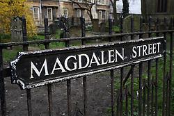 UK ENGLAND OXFORD 30MAR14 - Graveyard and street sign on Magdalen Street in Oxford, England.<br /> <br /> jre/Photo by Jiri Rezac<br /> <br /> © Jiri Rezac 2014