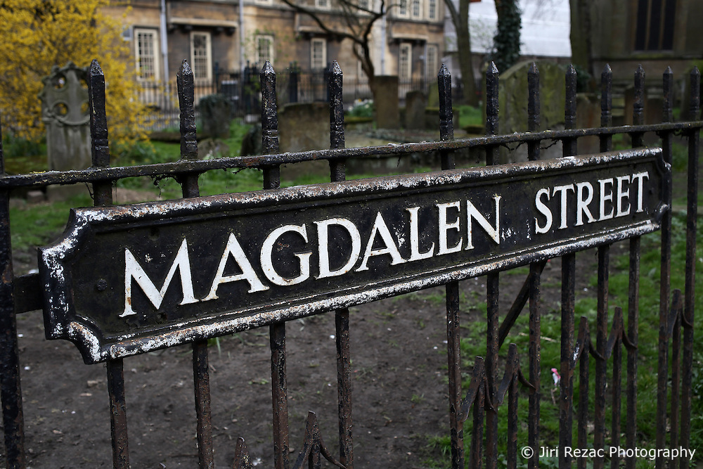 UK ENGLAND OXFORD 30MAR14 - Graveyard and street sign on Magdalen Street in Oxford, England.<br /> <br /> jre/Photo by Jiri Rezac<br /> <br /> &copy; Jiri Rezac 2014