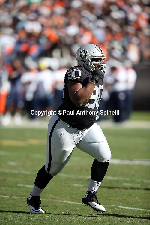 Oakland Raiders defensive tackle Dan Williams (90) runs cross field during the 2015 NFL week 5 regular season football game against the Denver Broncos on Sunday, Oct. 11, 2015 in Oakland, Calif. The Broncos won the game 16-10. (©Paul Anthony Spinelli)