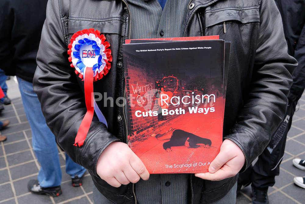 British National Party member handing out their 'Racism Cuts Both Ways' brochure in Liverpool 29th, November 2008 a week after thirteen members of the Liverpool branch were arrested by Merseyside police and charged with distributing racist literature likely to offend, UK