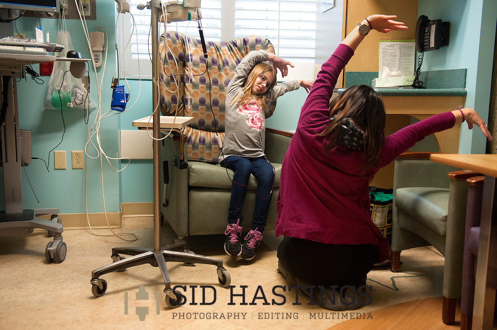 10 Feb. 2015 -- ST. LOUIS -- Aly Bauman (left), receiving outpatient treatment at The Costas Center at SSM Cardinal Glennon Children's Medical Center in St. Louis dances with Katie Bohn, a dance therapist associated the center Tuesday, Feb. 10. 2015. Aly and her family are from Ste. Genevieve. Photo © copyright 2015 Sid Hastings.