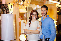 Portrait of a happy couple standing together in lights store